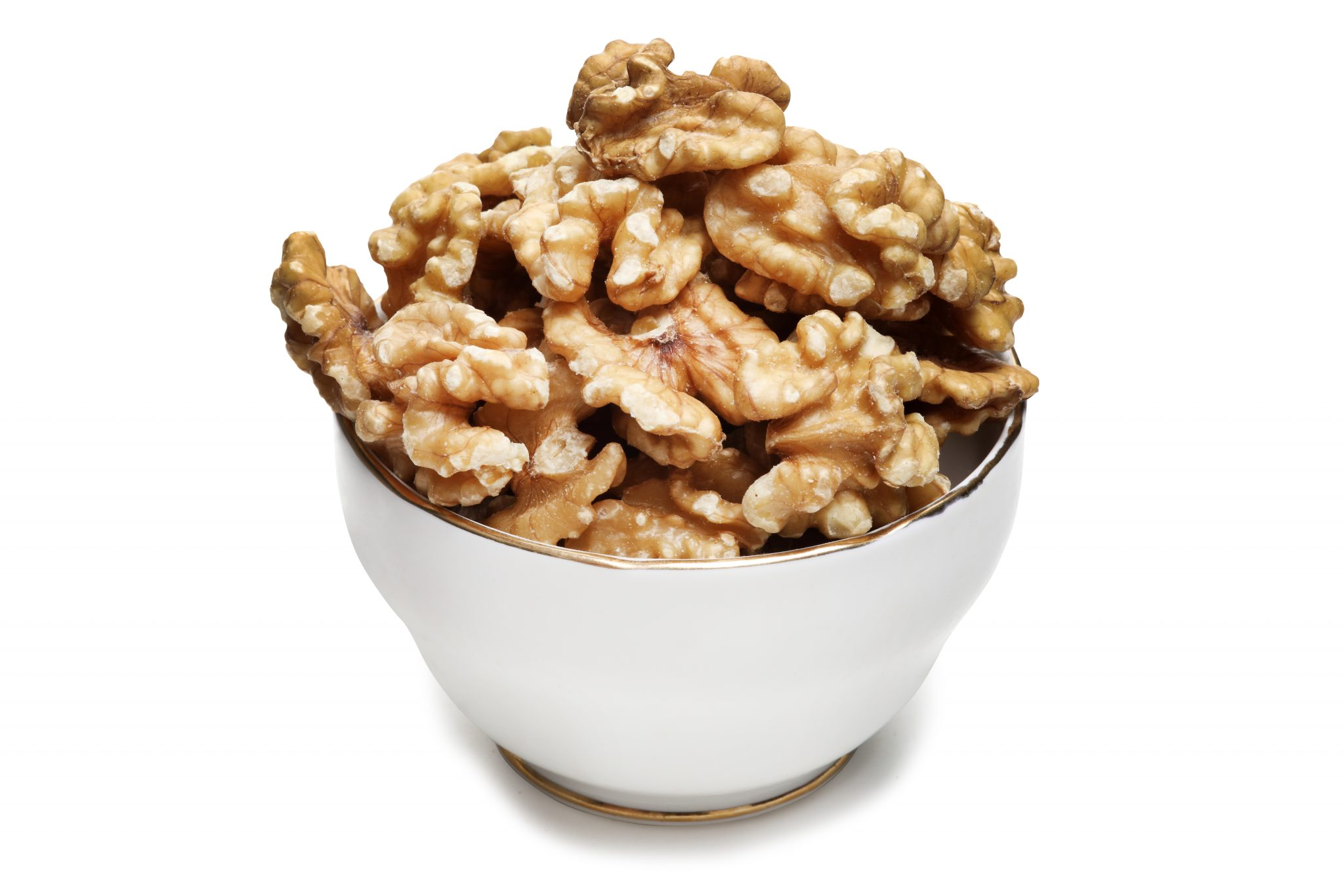 Chandras healthy vegan snack walnut halves in a white glass bowl