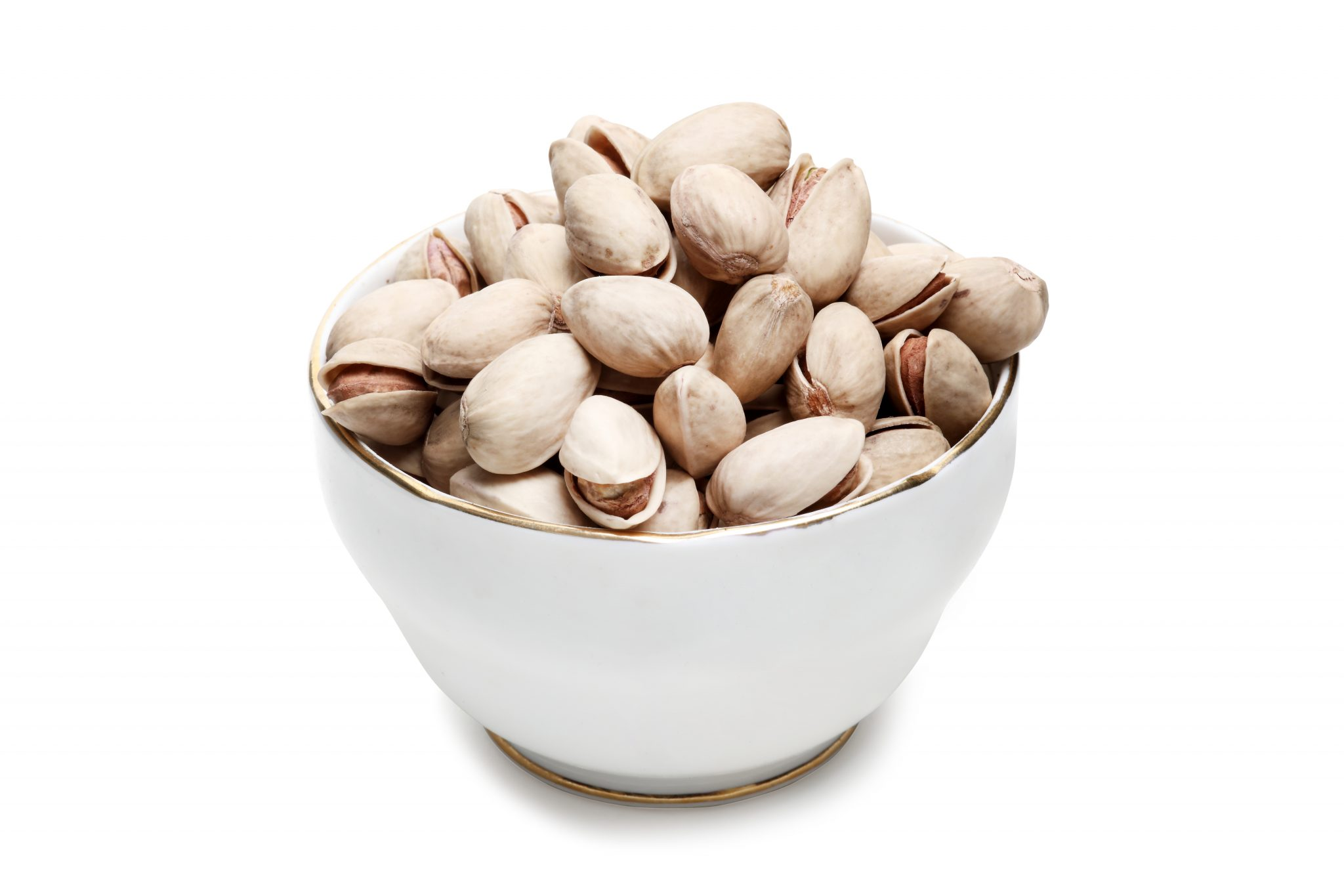 Chandras vegan snack Pistachios in shell in a glass bowl